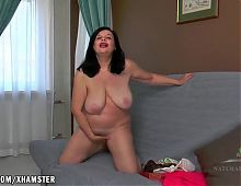 Nina fingers her big hairy pussy