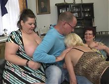 Three mature mothers sharing one young son